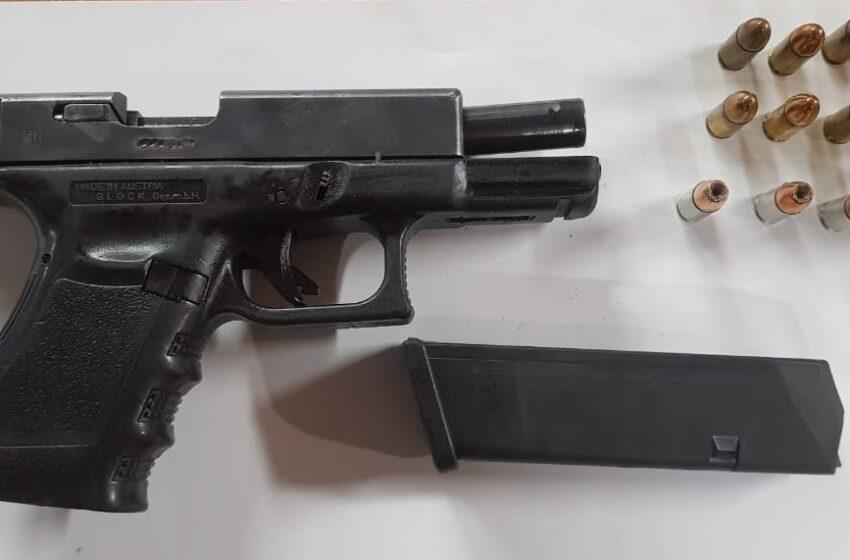 Contractor Held for Gun, Ammo