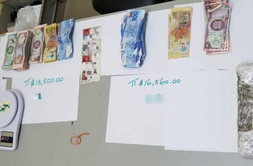 Police Arrest 2 Men, Seize Drugs, Ammo, Cash